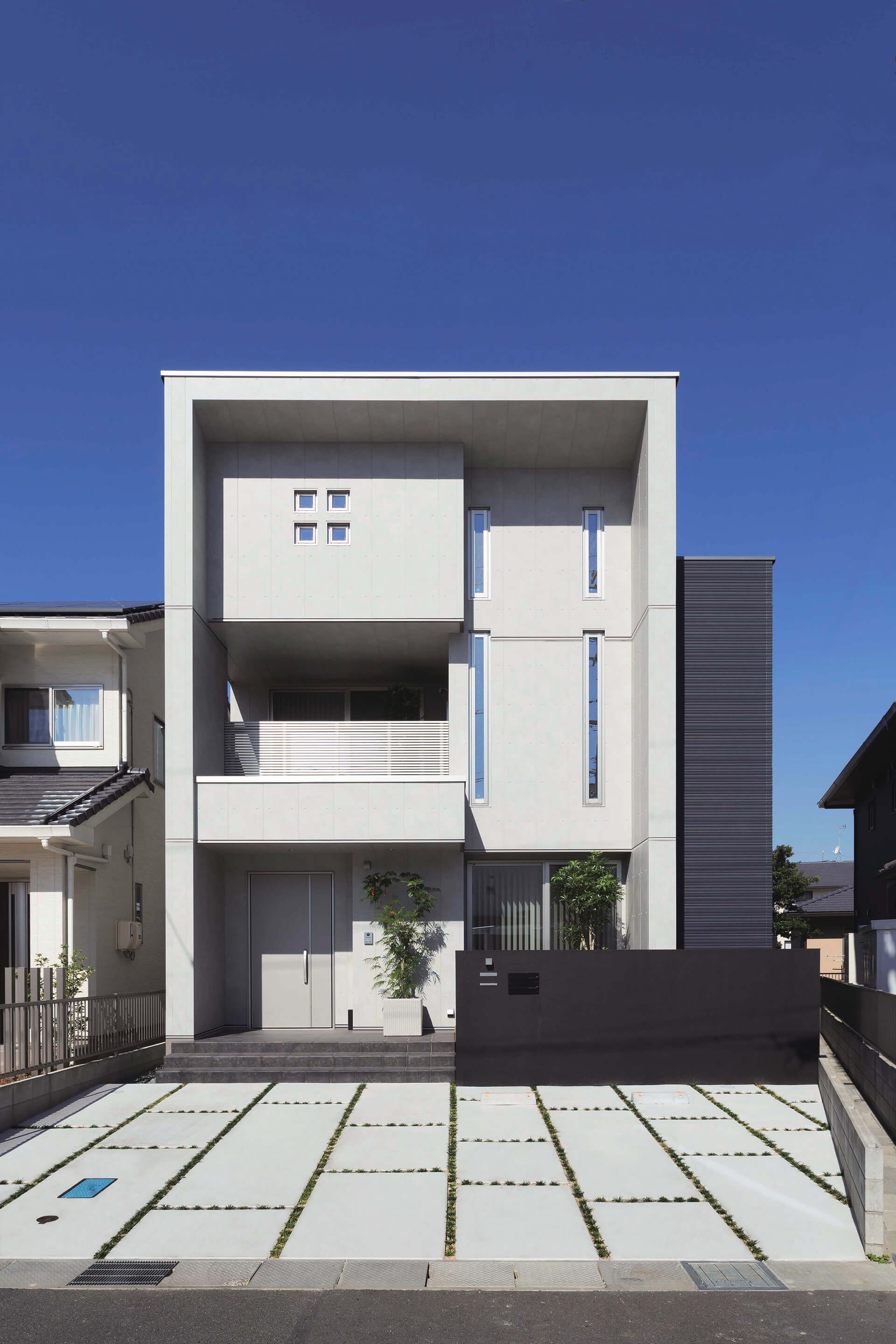 Modern residential building with small windows and Nichiha concrete series panel EmpireBlock