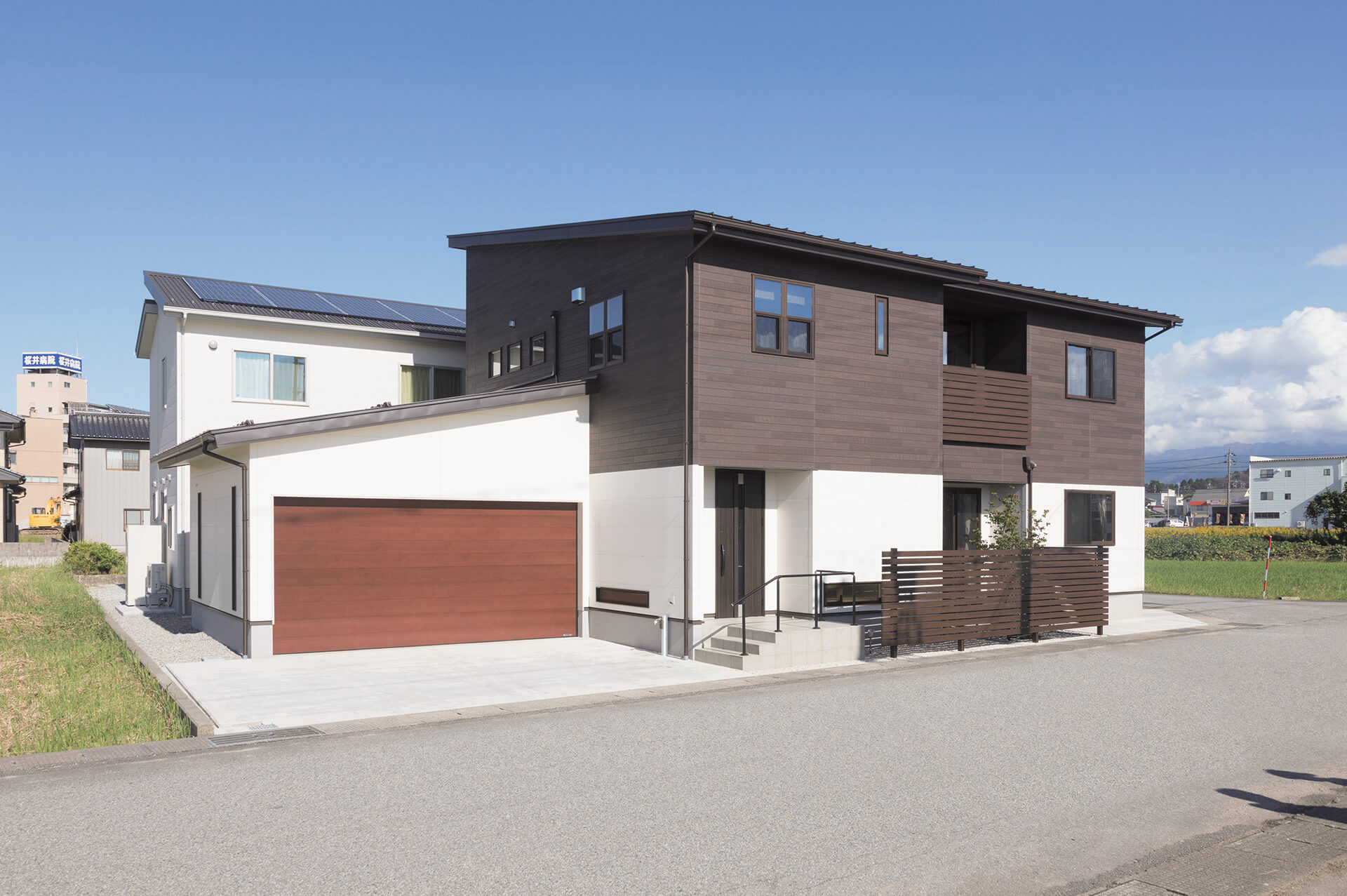 Modern home in Japan featuring Nichiha's dark faux wood fiber cement panels RoughSawn in color Espresso