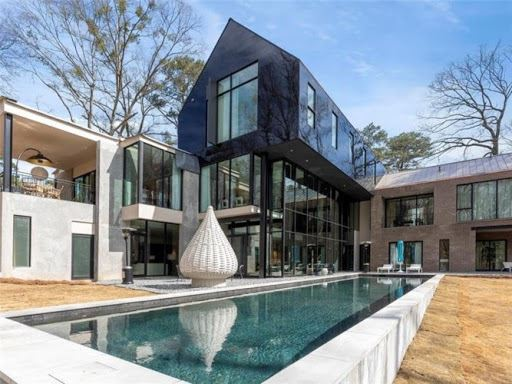 Exterior shot of ASO house featuring high-gloss panels and a stunning pool