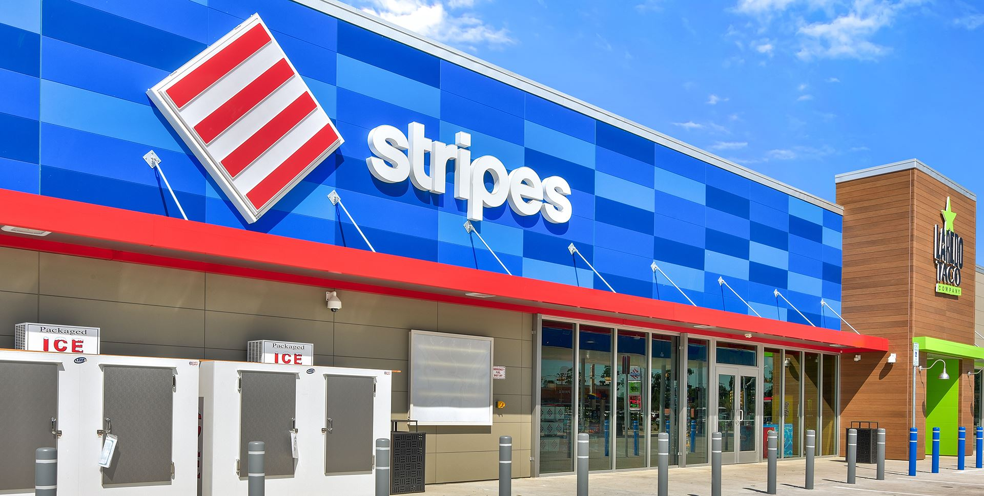 Front of Stripes convenience store with colorful blue Illumination panels