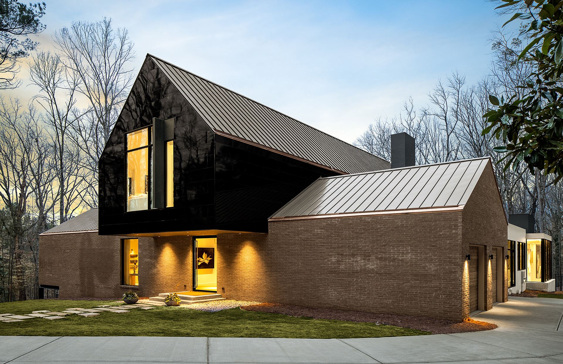 ASO house at dusk featuring Miraia panels in Onyx